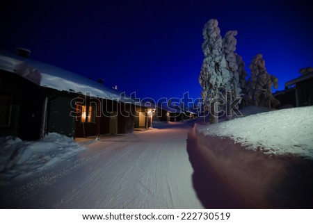 Beautiful snowy winter landscape with cottage cabin village in christmas vacation time near ski resorte - stock photo
