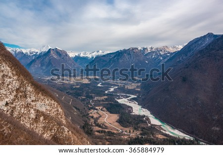 Beautiful Soca valley with villages, river and mountains - stock photo