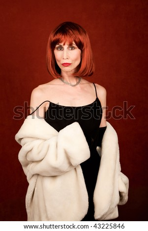 Beautiful socialite with fur coat and brassy red hair - stock photo