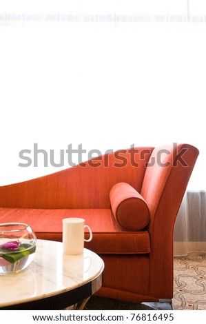 Beautiful sofa in a nice decorated residential living room - stock photo