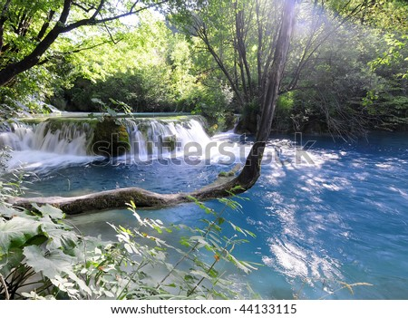 Beautiful soft waterfall in forest. Plitvice Lakes in Croatia. - stock photo