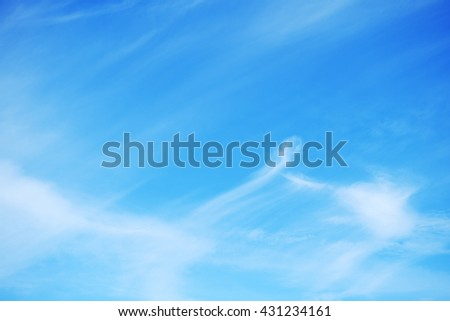 Beautiful soft white clouds and blue sky background. - stock photo