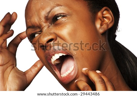 beautiful South African woman holding her face while screaming - stock photo