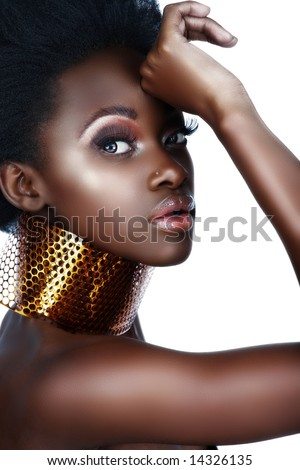 beautiful south African woman with bronze necklace and natural make-up with lots of shine - not isolated - stock photo