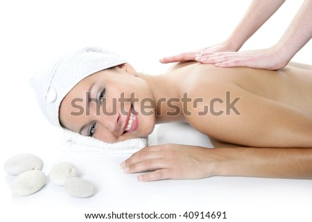 Beautiful spa blue eyes woman having massage over white background