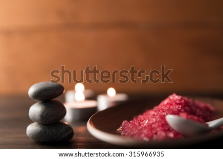 Beautiful Spa composition with aroma candles on wooden . Treatment, aromatherapy - stock photo