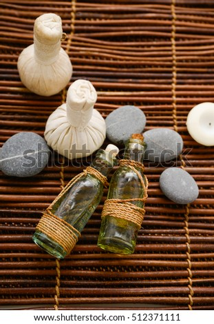 Beautiful spa composition with herbal ball on mat