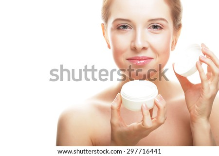 Beautiful spa girl holding jar of cream isolated on white background - stock photo