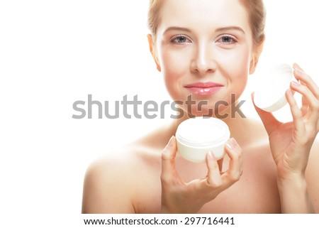 Beautiful spa girl holding jar of cream isolated on white background - stock photo