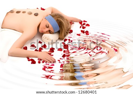 Beautiful spa girl with water reflection. - stock photo