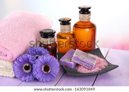 Beautiful spa setting on wooden table on bright background - stock photo