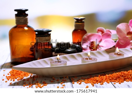 Beautiful spa setting with flower on bright background - stock photo