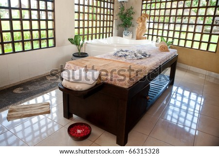 Beautiful spa therapy room with wooden windows in Bali - stock photo