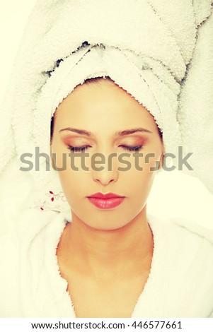Beautiful spa woman in bathrobe. - stock photo