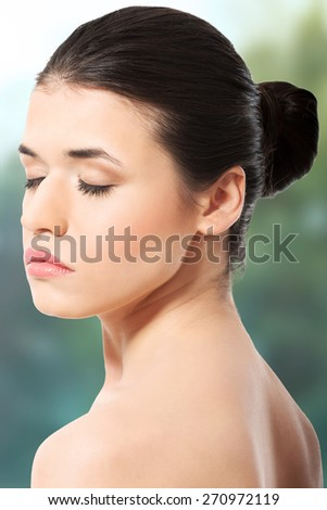 Beautiful spa woman with closed eyes. - stock photo