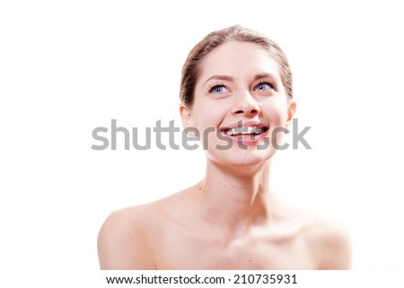 beautiful spa: young pretty woman with great dental care white teeth having fun happy smiling & looking up at white copy space background, portrait - stock photo