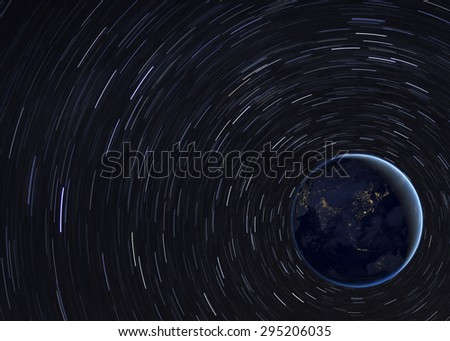 Beautiful space illustration with star trails. Elements of this image furnished by Nasa - stock photo