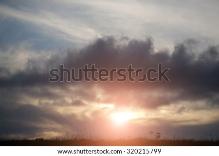 Beautiful spaciousness sundown landscape view from high hill top on cloudy grey blue yellow sky in dusk on natural evening background, horizontal picture - stock photo