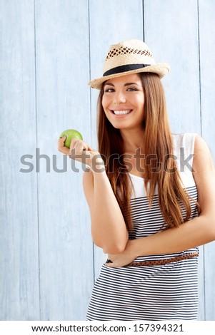 Beautiful Spanish Latino Girl with healthy apple - stock photo