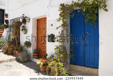 beautiful spanish street decorated with flowers - stock photo