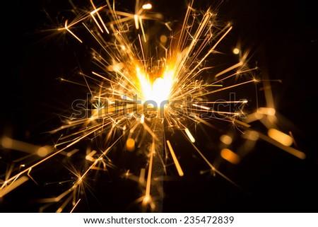 beautiful sparkler on black background  - stock photo