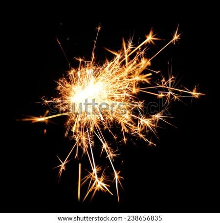 Beautiful sparkler on black background, close up - stock photo