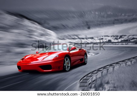 beautiful speed red sportscar on the road - stock photo