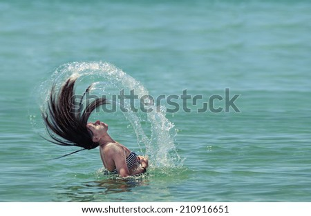 Beautiful spiral girl in the water waving hair  Amazing portrait of beautiful teenage girl making spiral hair figure while taking head out of water., VINTAGE - stock photo