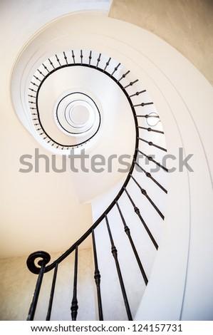 beautiful spiral staircase at a villa - stock photo