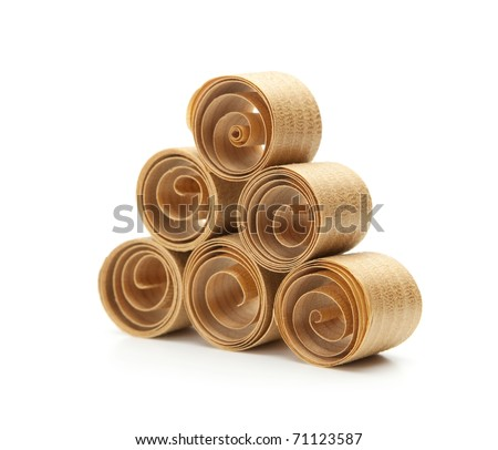 Beautiful spiral wood shavings , created by a hand plane. stacked up to form a triangle. - stock photo