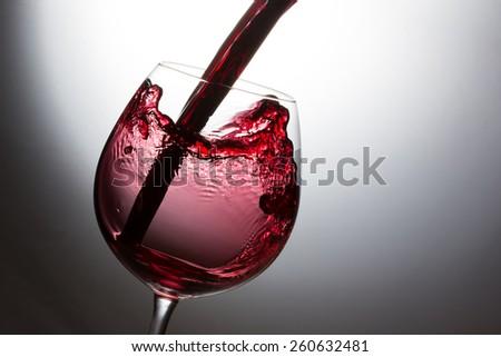 Beautiful splash of red wine - stock photo