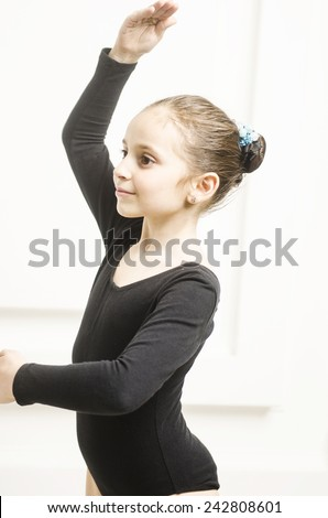 Beautiful sport training girl portrait in leotard in white room. classic portrait of gymnastics girl - stock photo