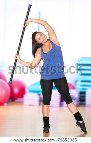 Beautiful sport woman doing power fitness exercise at sport gym. Dumbbell weight! - stock photo