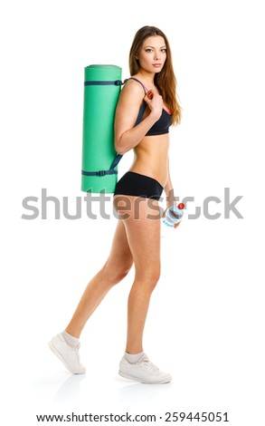Beautiful sport woman mat for fitness, bottle of water doing sport exercise, isolated on white background - stock photo