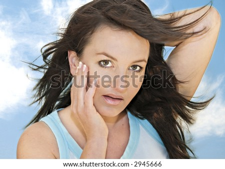 beautiful sportive woman with blue background