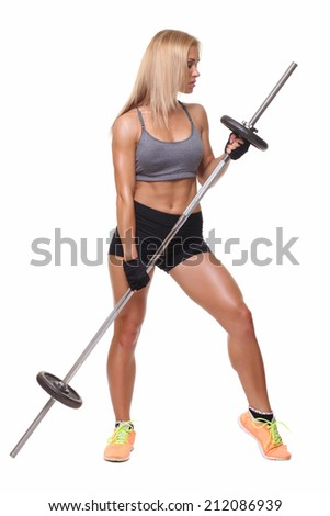 beautiful sports fitness girl with a barbell - stock photo