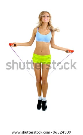 Beautiful sportsgirl with skipping rope isolated on white - stock photo