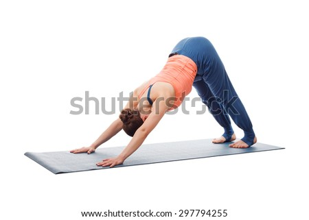 Beautiful sporty fit yogini woman practices yoga asana adhomukha svanasana - downward facing dog pose isolated on white - stock photo