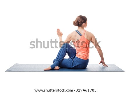 Beautiful sporty fit yogini woman practices yoga asana ardha matsyendrasana - half spinal twist pose isolated on white background - stock photo