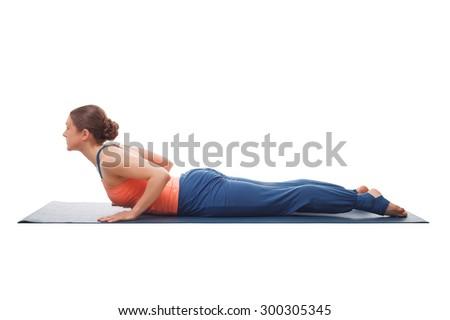 Beautiful sporty fit yogini woman practices yoga asana bhujangasana - cobra pose beginner variation isolated on white background - stock photo