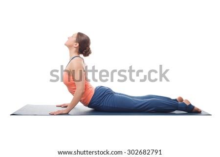 Beautiful sporty fit yogini woman practices yoga asana bhujangasana - cobra pose isolated on white background - stock photo