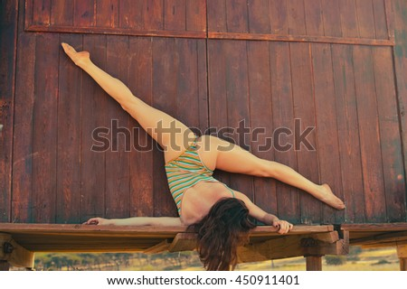 Beautiful sporty sexy female practicing fitness or yoga on the beach, nature relaxation outdoors background - stock photo
