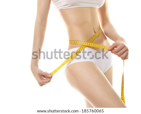 Beautiful sporty woman body  with yellow measure type - stock photo
