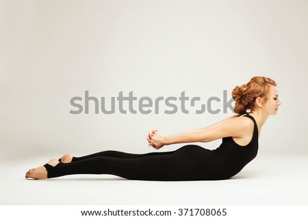 Beautiful sporty woman doing exercise. Locust pose