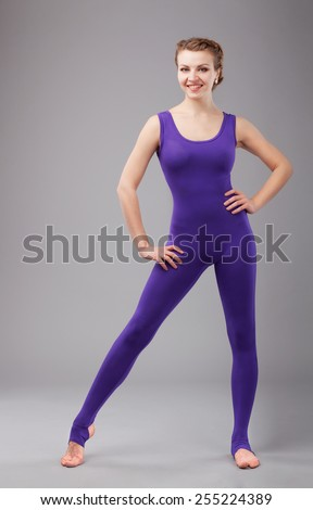 Beautiful sporty woman in violet tights - stock photo
