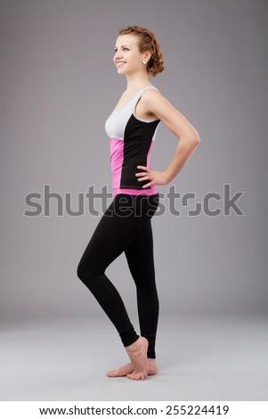 Beautiful sporty woman. Studio shot - stock photo