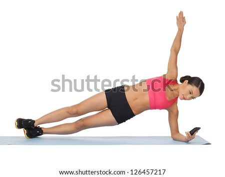 beautiful sporty woman with smartphone doing exercise