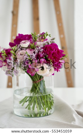 Beautiful spring flowers in a glass vase