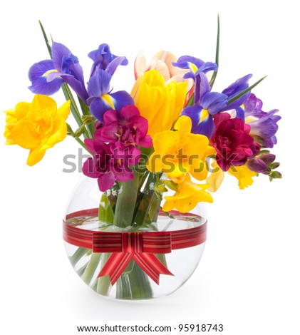 Beautiful spring flowers in glass - stock photo