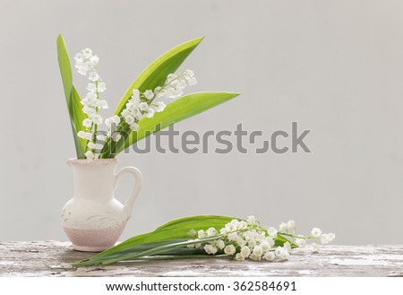 beautiful spring flowers on old wooden table